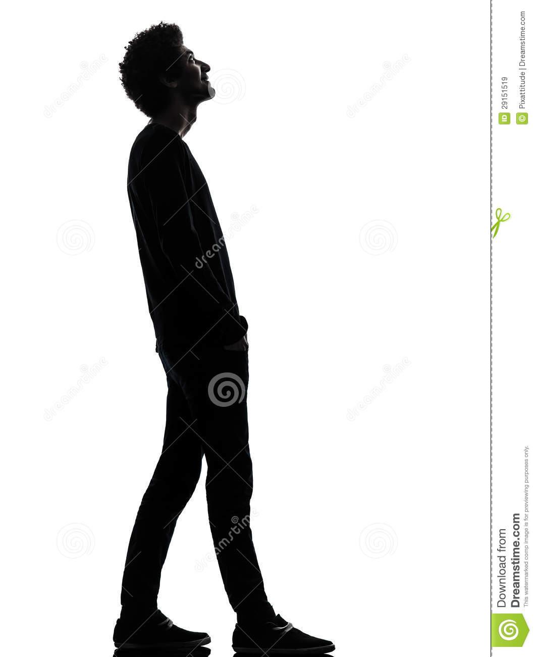 Man standing sideways looking down