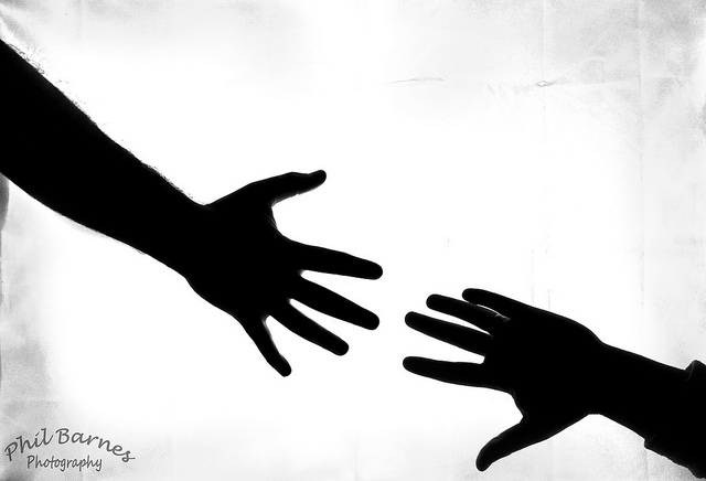 Reaching hand silhouette